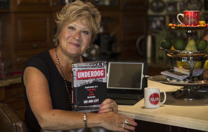 "Toronto Sun columnist, Sue-Ann Levy with her new book ""Underdog"" on Monday August 1, 2016. Craig Robertson/Toronto Sun/Postmedia Network"